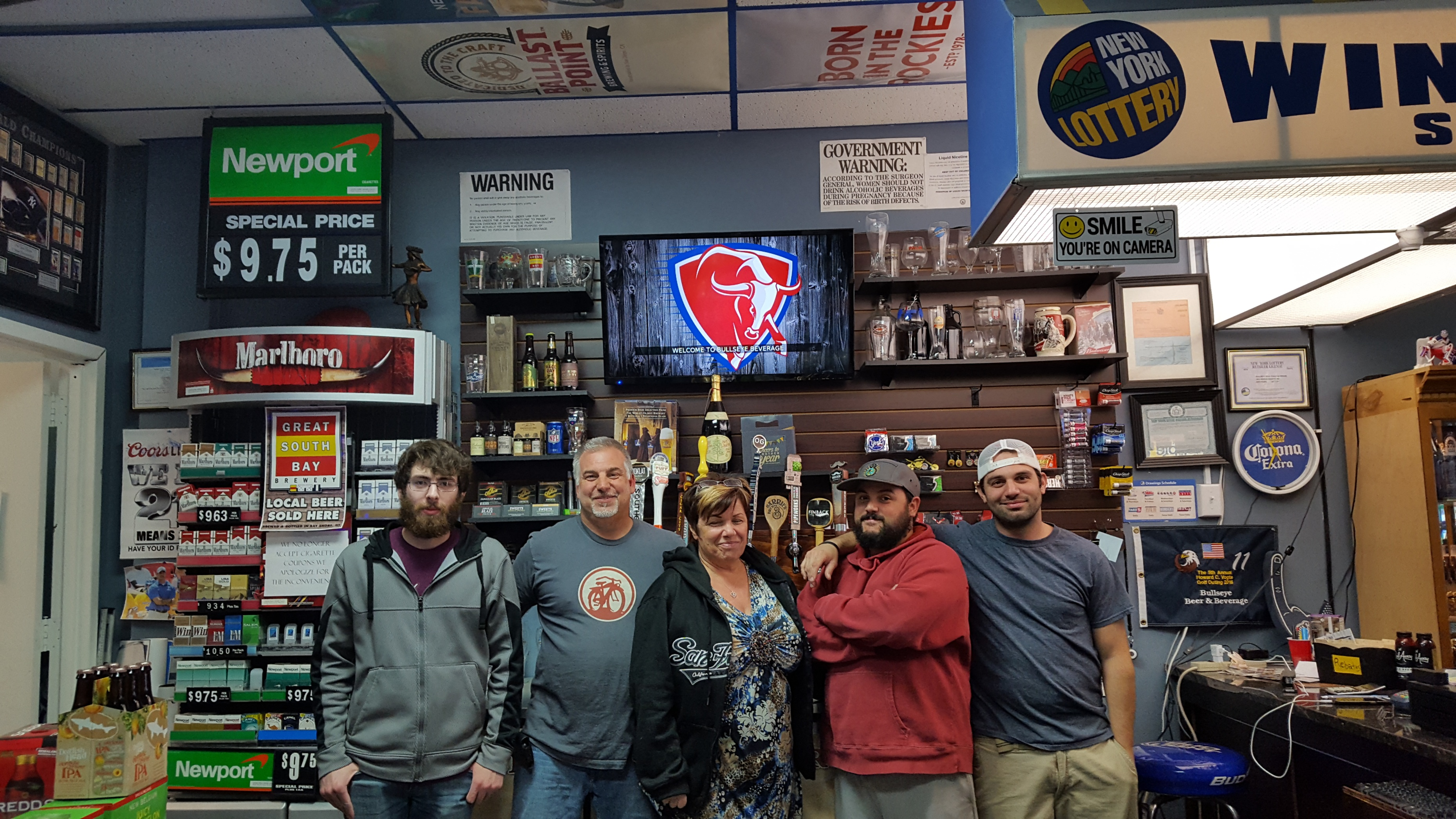 5 Adults Standing in a Liquor Store