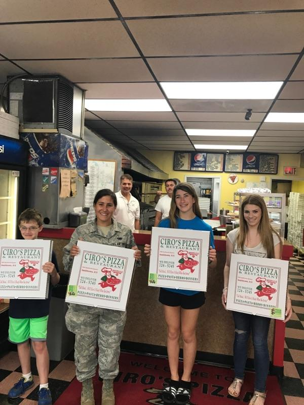 Kids and a Military Member Holding Pizza Boxes